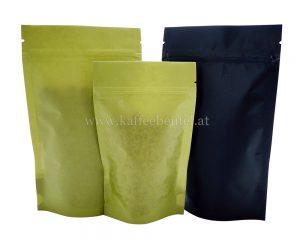 Grüne und schwarze Papiertüte